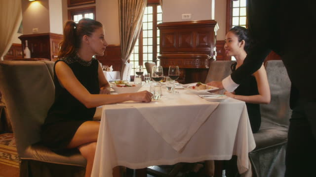 People dining at restaurant, leisure in hotel, women, girls, friends video