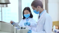 people doing chemical experiment in lab 4k video