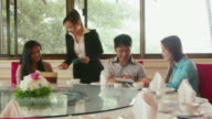 People eating at chinese restaurant, man, women, waiter video