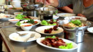 People eating Thai food in restaurant video
