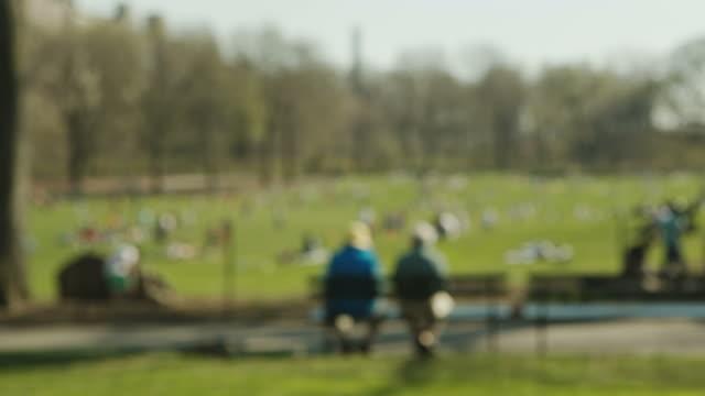 People enjoy spring in Central Park New York Manhattan Blur video