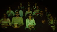 people enjoying in the cinema watching a 3d movie video