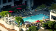 People Enjoying Swimming Pool In Apartment Complex video