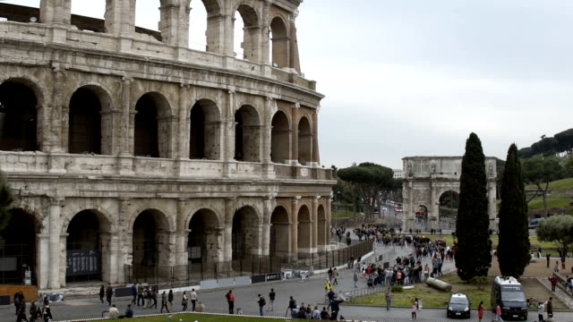 People exploring beautiful Coliseum amphitheater, tourism in Rome, Italy video