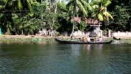 people float by the boat in Kerala backwaters  in Kerala, India video