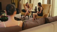People, friends, girls, women drinking wine, talking in hotel room video