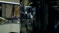 People go on the elevator at the mall video