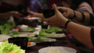 People have dinner food party together video