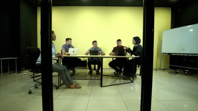 People having business meeting video