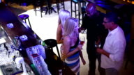 People having drinks in a bar. video
