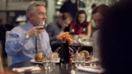 MS R/F People having food in restaurant, waiter serving food video