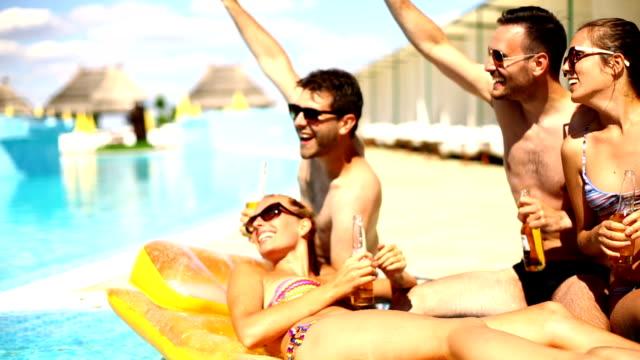 People having fun at swimming pool. video