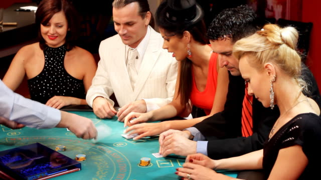 People having fun at the Blackjacks table in casino. video