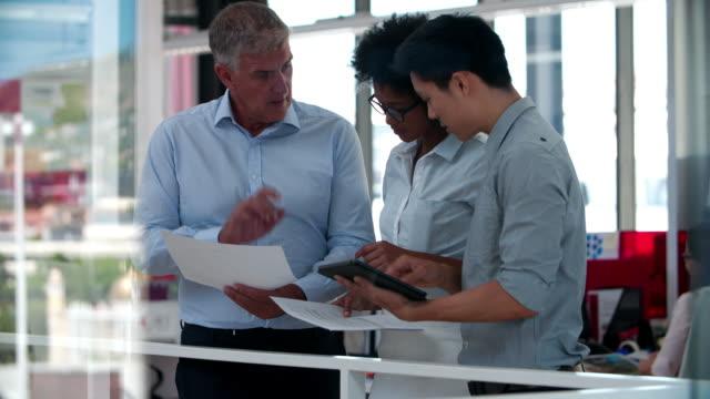 People Having Informal Meeting In Modern Open Plan Office video