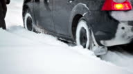 People helping to push car from snowdrift video