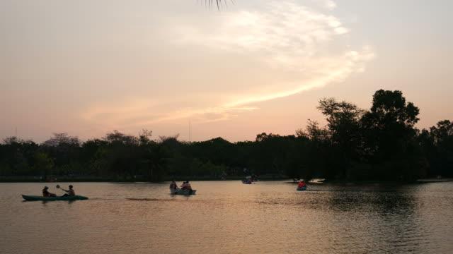 People in canoe in public park video