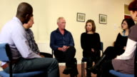 People in Group Therapy - Older man speaking video