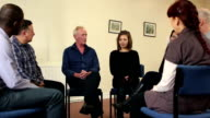 People in Group Therapy - Older man speaking (DOLLY) video