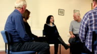 People in Support Group - Young woman speaking, Counselling, Therapy video