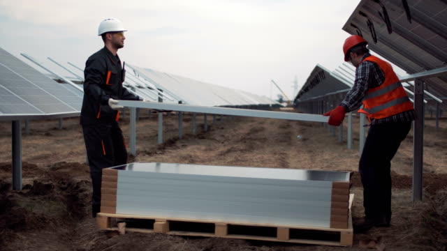 People mounting solar panels video