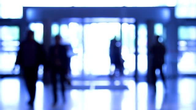 People moves through revolving door video