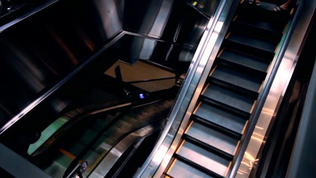 People moving on escalator. video