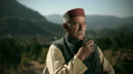 People of Himachal Pradesh: Senior man meditating with beads chant video