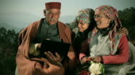 People of Himachal Pradesh: Senior man using laptop with family video