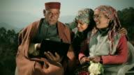 People of Himachal Pradesh: Senior man using laptop with family video