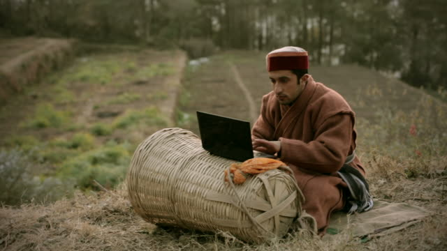 People of Himachal Pradesh: Young farmer using laptop video