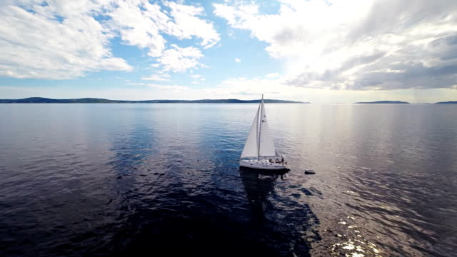 AERIAL WS People On A Sailboat In The Sea video