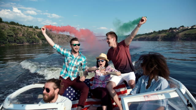People on boat with colored smoke video