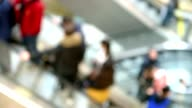 People on escalator video