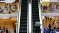 people on escalator video