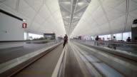 People on travelator or moving walkway in Hong Kong International Airport video