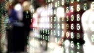 People overlaid by binary code and numbers. video