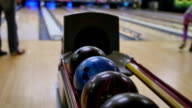 People Pickup Bowling Balls from Return at Alley video