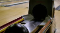 People Pickup Bowling Balls from Return Tray at Alley video