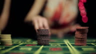 People placing bets for roulette in casino video