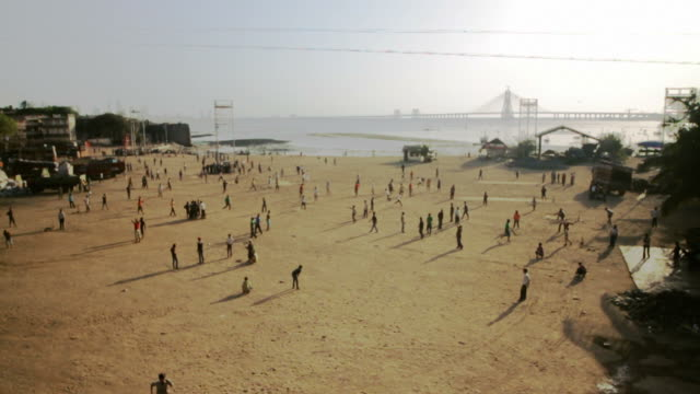 People playing cricket in India video