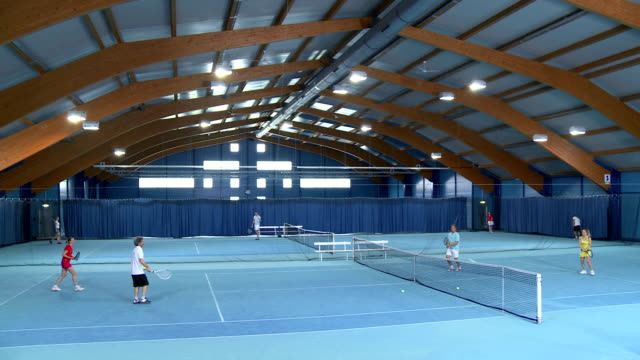 CS People Playing Mixed Doubles In Tennis video