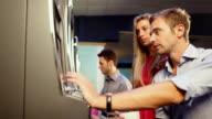People playing slot machine at casino video
