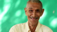 People Portrait Happy Elderly Hispanic Man Laughing At Camera video