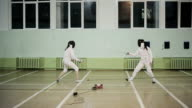 People practicing fencing duel video