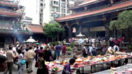 People pray in Longshan Buddhist temple in Taipei city, Taiwan video