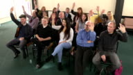 People raising hands in meeting - CRANE HD video