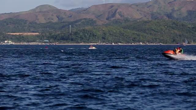 People riding jet ski on blue sea video