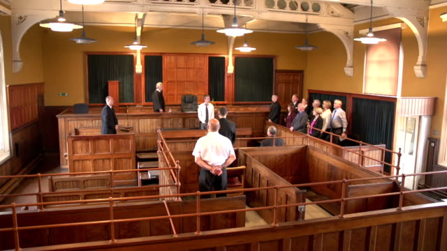 People rise as Judge walks into Court -Crane video