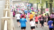 People running at half Marathon event video