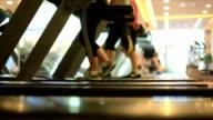 People running on treadmills video